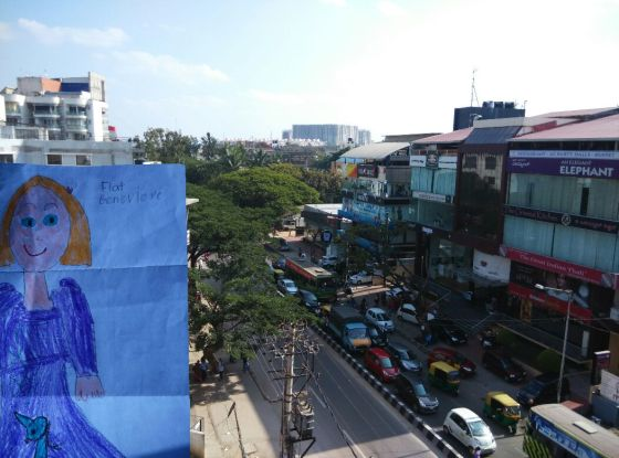 Flat G admired the rooftop view of a busy Bangalore road while sipping Masala Chai!